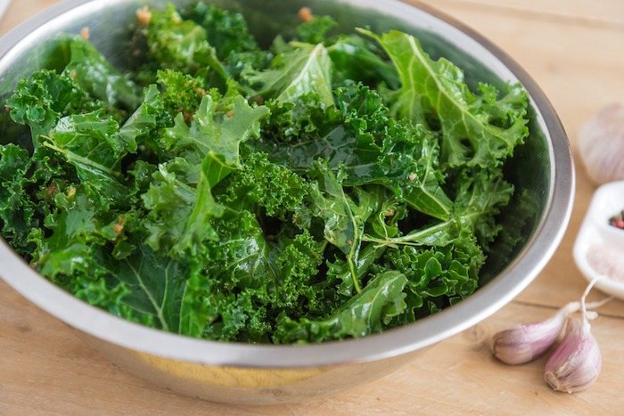 Kale leaves in a silver bowl